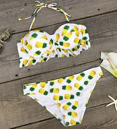You wanna know what we love most about this Wow-worthy swimwear? The design comes down the entire set and it is a stunning look of bright color, lovely fruit printing and amazing ruffle hem. You will want to pull it out of your closet to next beach trip.