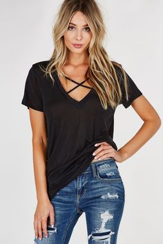 Wide V-neck short sleeve top with an oversized fit. Lightweight material with straight hem all around. - Rayon-Polyester blend - Made in USA - Model is wearing size S - Runs true to size - Hand wash c