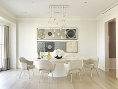 This stunning white dining room was completed by Jessica Lagrange Interiors. #luxeChicago