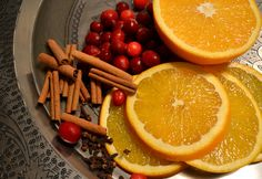 Christmas Stove Top Potpourri. cut up an orange or a lemon, place it in a small pot of simmering water.  Throw in some cinnamon sticks, a couple dashes of nutmeg, a tsp. of cloves and cranberries for color! - -the poor sophisticate: Simple Christmas Details