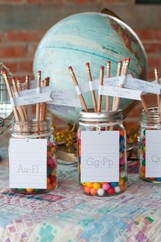 mason jar, pencil, and gumball escort cards
