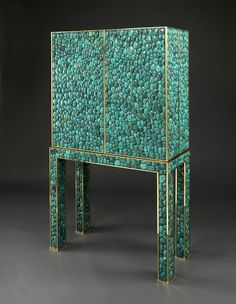 Turquoise and brass cabinet by Kam Tin, c. 1980.via http://angiehranowsky.com/turquois
