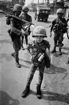 """This boy was called a """"little tiger"""" for killing two """"Vietcong women cadre"""" - his own mother and teacher, it was rumored."""