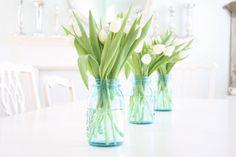 White tulips in mason jars