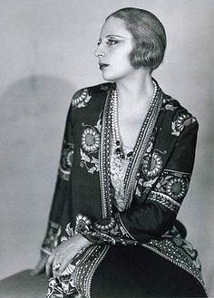 "Tamara de Lempicka, born Maria Górska in Warsaw, Poland, was a Polish Art Deco painter and ""the first woman artist to be a glamour star""."