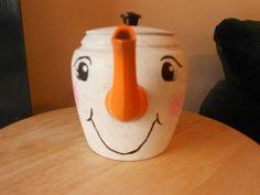 This snowman is created from an aluminum teapot. Build A Snowman, Snowman Crafts, Winter Christmas, Christmas Decor, Christmas Ornaments, Painted Snowman, Snowman Faces, Tea Kettles, Primitive Snowmen