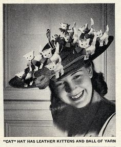 """Cat"" hat has leather kittens and ball of yarn."