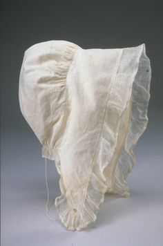 "1820-30 Woman's Cap. eight   10.75"" high x 8.25"" wide. (c) Pocumtuck Valley Memorial Association, Deerfield MA."