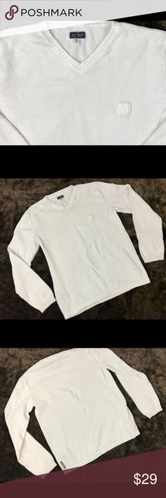"""Armani Jeans White Cotton V-Neck Sweater Large ARMANI JEANS V-NECK sweater. This light weight 100% Cotton white v-neck sweater.  Size : LARGE  AJ embroidered on the left chest area and a small tag on the side of the sweater as seen in the pictures. The original retail price was over $220. Measurements  18"""" across shoulders 21 1/2"""" across chest  27"""" length from back collar.  Excellent used condition. Armani Jeans Sweaters V-Neck"""