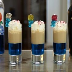SMURF SHOTS 1 part Blue Curaçao 1 part Irish Cream Garnish: Whipped Cream, Red Sugar, Smurf Gummies PREPARATION 1. Pour blue Curaçao into a shot glass, about one third of the way. 2. Carefully layer Irish Cream over. 3. Top with whipped cream, red sugar, and a smurf gummy. DRINK RESPONSIBLY!