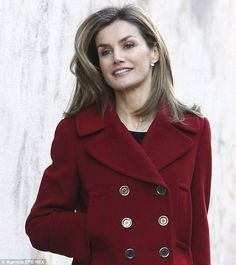 Low key: Spain's Queen Letizia arrives on foot for the board meeting of FEDER in Madrid