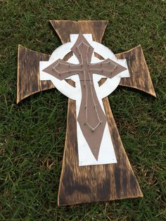 Decorative cross I made from some plywood and scrap metal...