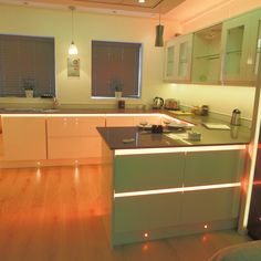 RGB Colour Changing Strip #orange #green #kitchenlighting #modernkitchen