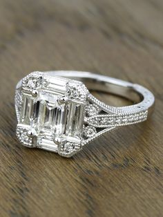 Check out the stunning detail of this Antique Statement Emerald Diamond Engagement Ring in White Gold!