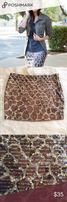 Express Leopard Sequin Skirt Gorgeous Express leopard sequin skirt in perfect condition. No sequins missing! No trades! Bundle & save 5%! 1gbdcb Express Skirts Mini
