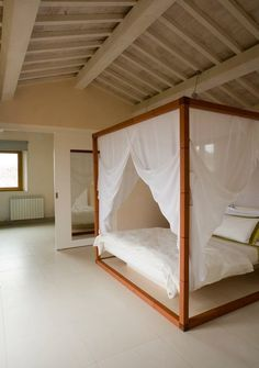 Love the way the canopy is hung. Canopied bed #beachhouse