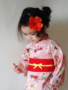 I have actually made kimono tops for kids out of this same fabric, I love it and had the red version as well.