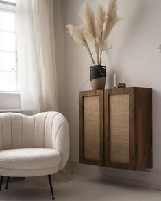 Rustic stained ikea ivar cabinet hack attached to the wall. Neutral toned armchair is situated next to the cabinet Ikea Ivar Cabinet, Ikea Cabinets, Narrow Rooms, Deco Retro, Ikea Furniture, Interior Inspiration, Diy Home Decor, Interior Design, Ikea Interior