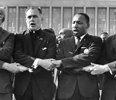 On July 21, 1964, Fr. Hesburgh stood hand in hand with Martin Luther King, Jr.