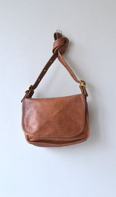 Vintage Coach Patricias Legacy cross body bag. A heavy flap which conceals a large slip pocket on the front of the bag. The inside compartment is