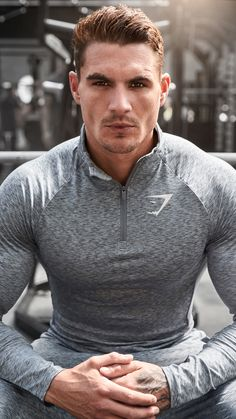 Ross Dickerson styling the Charcoal Marl Fallout 1/4 Zip Pullover, finished with a funnel neck collar, and that Gymshark form fit.