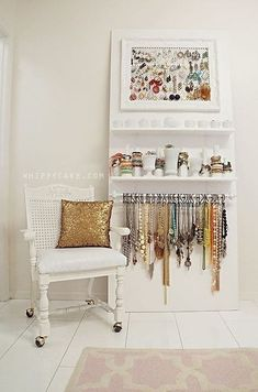 Open storage for jewelry using a rod and curtain hooks, various containers and bases...so pretty!