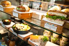 Display case of sandwiches, salads, and beverages at the CIA Bakery Café in San Antonio, TX.
