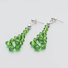 Swarovski Bicone Earrings 45mm Fern Green  Dimensions: length: 4,5cm stone size: 4 and 6mm Weight ( silver) ~ 0,90g ( 1 pair ) Weight ( silver + stones) ~ 3,90g Metal : sterling silver ( AG-925) Stones: Swarovski Elements 5328 4 & 6mm Colour: Fern Green 1 package = 1 pair  Price 7 EUR