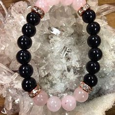 @Pingrann from aida826 on Pinterest: Black Onyx and Rose Quartz beaded bracelet with faux rose gold details. 8 mm beads. Black Onyx - It can help release negative emotions such as sorrow and grief. It is used to end unhappy or bothersome relationships. Onyx guards against negativity Rose Quartz - stone of love Please - #pingrann #beadwork #bracelets #handmade #braceletsoftheday #beaded #bracelet #beadedjewelry #braceletsformen #beads #braceletstacks #beadedtack #handmadejewelry…