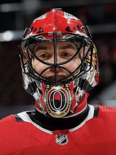 OTTAWA, ON - NOVEMBER Mike McKenna of the Ottawa Senators looks on during warmup prior to a game against the Buffalo Sabres at Canadian Tire Centre on November 2018 in Ottawa, Ontario, Canada. (Photo by Andre Ringuette/NHLI via Getty Images) Goalie Mask, Nhl Games, Buffalo Sabres, Canadian Tire, Football Helmets, Hockey, Ottawa Ontario, Centre, November