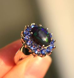 Silver ring with rhodium finish. Rocks : opal, blue zirconium Sold by Jewellry 157,00 $