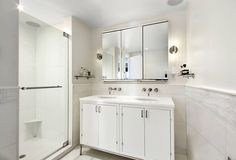 Contemporary 3/4 Bathroom with Wall sconce, Daltile Marble Collection First Snow Elegance 1x2 Split Face Mosaic, Flush