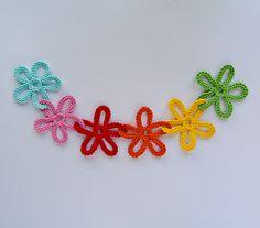 Ravelry: Garland of Colorful Flowers pattern by Carolina Guzman.