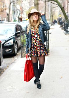 Shop this look on Lookastic:  http://lookastic.com/women/looks/tote-bag-ankle-boots-tights-skater-dress-pendant-biker-jacket-hat/6607  — Red Leather Tote Bag  — Black Suede Ankle Boots  — Black Tights  — Black Print Skater Dress  — Gold Pendant  — Blue Denim Biker Jacket  — Beige Wool Hat