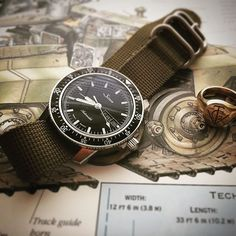 Watches Ideas Built like a tank but with the elegance of jet fighter, the highly overlooked Sinn 104 Sa on my lucky RAF olive zulu strap. Retro Watches, Modern Watches, Luxury Watches, Vintage Watches, Cool Watches, Watches For Men, Men's Watches, Sinn Watch, Nato Strap