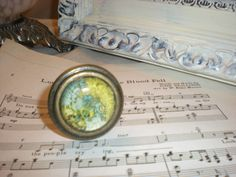 ~~~ This listing if for 1 Knob ~~~    This vintage map knob is truly unique. The map has blue and yellow hues is enclosed with a glass top with an