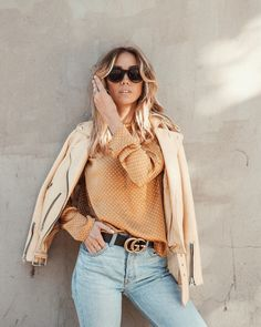 Jacket, All Saints. Top, Gina Tricot (in stores soon). Jeans, Reformation. Belt, Gucci. Sunglasses, Céline