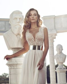 Stunning lace gown with silver belt by Julie Vino.
