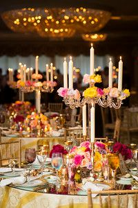 striped cloths, bright roses, crystal candelabras