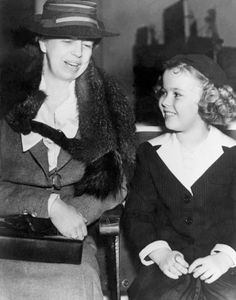During her travels to Hollywood, Calif., First Lady Eleonor Roosevelt meets Shirley Temple, in 1938.