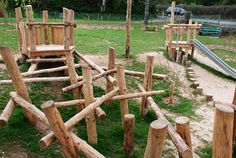 Structure on the right: tower with log steps and slide. Playground Build & Design | Natural Child Play | Earth Wrights Ltd