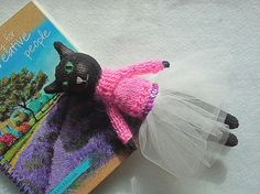 Crocheted Amigurumi Black cat / Amigurami soft toy in a pink