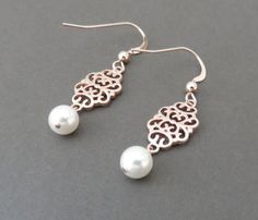 Rose Gold Earrings, Filigree Earrings, Rose Gold and Pearl Earrings https://marciahdesigns.com/products/rose-gold-earrings-filigree-earrings-rose-gold-filigree-pearl-earrings-rose-gold-and-pearl-dainty-bridesmaid-gift-wedding-earrings