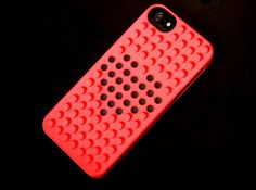 iPhone 5 cover instilled with a cut out heart pattern.