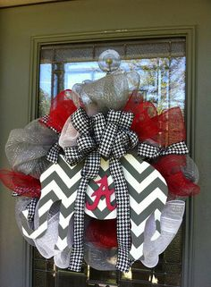 This Alabama football wreath is made with grey, white & red deco mesh with houndstooth ribbon. It's topped with a houndstooth bow and a hand painted wood chevron elephant with a Alabama A on it. The wreath measures approx Alabama Football Wreath, Alabama Wreaths, Crimson Tide Football, Alabama Crimson Tide, Alabama Decor, Alabama Crafts, Sweet Home Alabama, Alabama Room, Football Crafts
