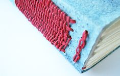 Long stitch/link stitch with indigo cave paper. Part of my 50 Book challenge. Get updates here: http://vintagepagedesigns.com/50-book-project/