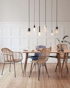 Scandinavian dining room with minimalist light feature