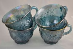 4-harvest-blue-princess-carnival-glass cups. Indiana Glass Leaf Pattern.
