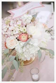 lush, full & low with light blushes & pinks with white & cream! Nice to see the Eucalyptus thrown in for a soft touch!