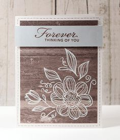 love the wood paper, the embossed corner design, and the muted colors (Kristina Werner http://www.kwernerdesign.com/blog/?p=8272#)